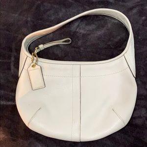 Coach white purse.